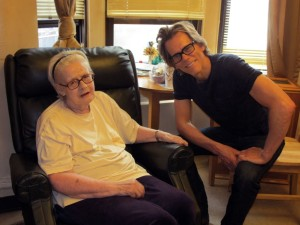 Kevin Bacon smiling with Encore 49 Resident